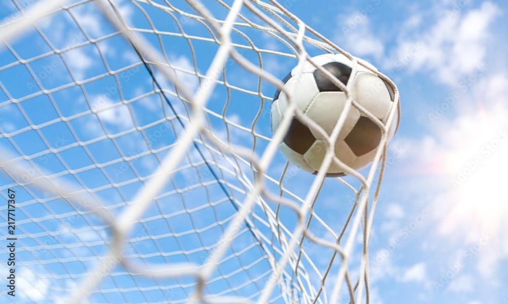 Soccer ball in goal, sport concept