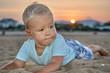 Cute boy sunset portrait on the beach