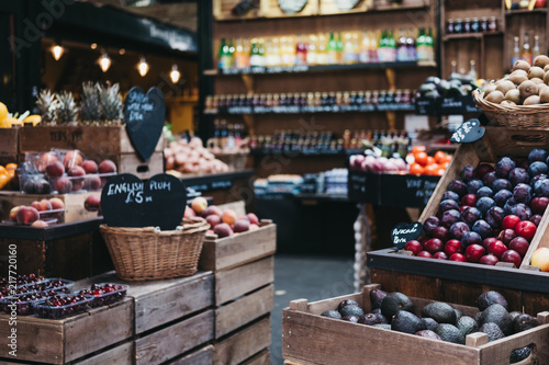 Cuadros en Lienzo Variety of fresh fruit and vegetables in wooden crates, on sale at a market stall