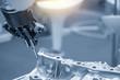canvas print picture - The robot for manufacturing  the aluminum automotive part .The automotive part quality control concept.
