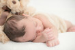 Cute newborn baby sleeping on a blanket - happy family moments concept