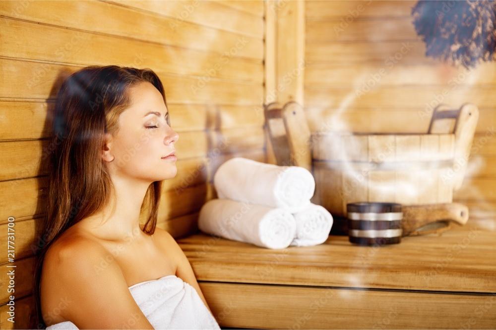 Fototapeta Young woman relaxing in spa