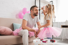 Side View Of Daughter Doing Makeup To Father