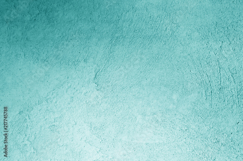 Photo  Grungy cement wall in cyan color.