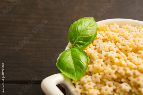 Closeup view of dry pasta with fresh basil
