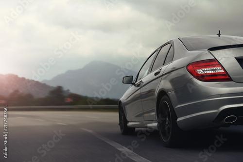 Fotografia, Obraz car drive on high speed in behind city