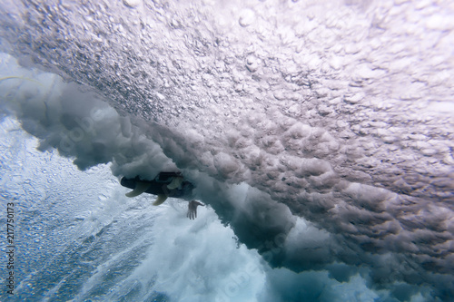 Low angle view of surfboard amidst waves breaking undersea at Maldives