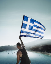 Rear View Of Man Waving Greek ...
