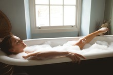 Woman Taking A Bath In Bath Tub