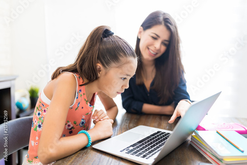 Vászonkép Girl And Teacher Using Laptop At Table
