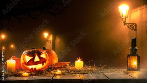 Scary horror background with halloween pumpkin jack o lantern