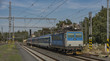 Fast train in Karlovy Vary station in hot summer day