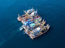 Aerial View Of A Large Number Of Fishing Trawlers Operating Together Illegally In A Marine Reserve