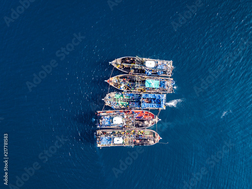 Aerial view of a large number of fishing trawlers operating together illegally i Wallpaper Mural