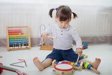 Baby Girl Play Drum At Home