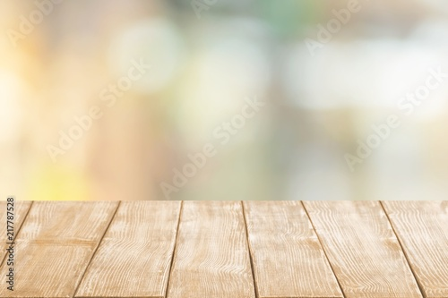 Wooden table and blur with bokeh background
