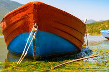A Closer Look To A Beautiful Blue And Red Fishing Boat, Outside A Greek Village