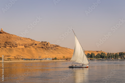 Photo Stands Egypt Felucca Sailing on the Nile River in Aswan, Egypt. A sailboat in the Nile.