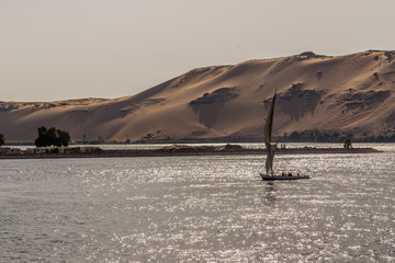 Sundown at Nile. Felucca Sailing on the Nile River in Aswan, Egypt.