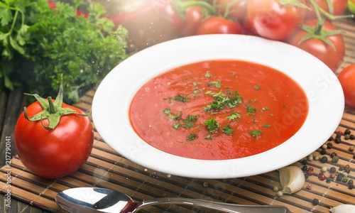 Fresh tomato soup on desk Fototapeta