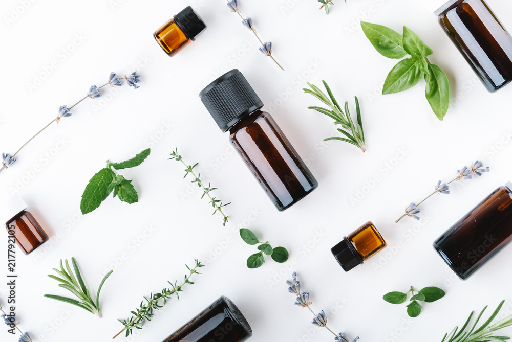 Fototapety, obrazy: essential oils with botles and herbs on white background