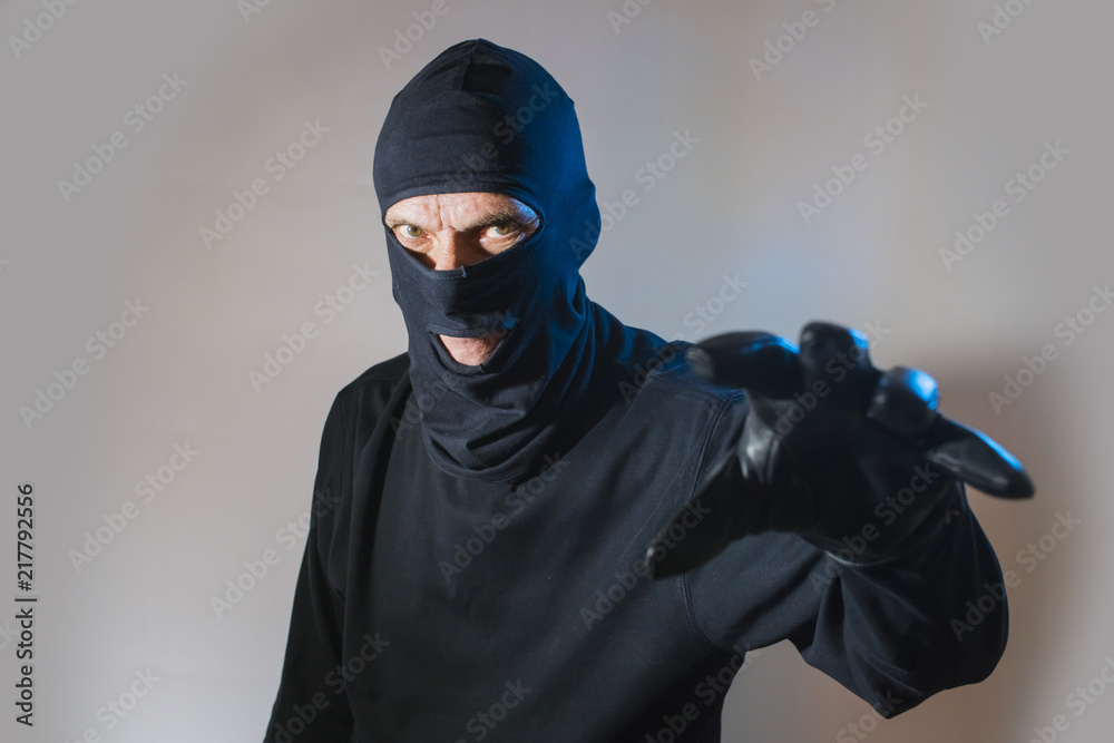 Fototapeta criminal terrorist the thief the robber