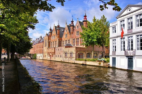 Staande foto Brugge Medieval buildings lining the picturesque canals of Bruges, Belgium