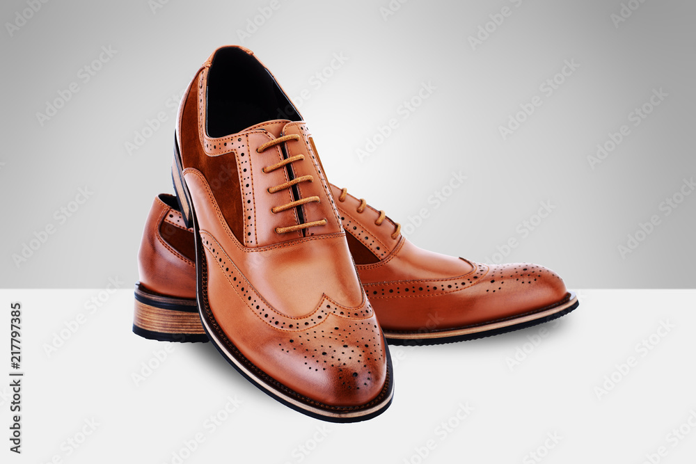 Fototapeta Brown men's shoes on split background
