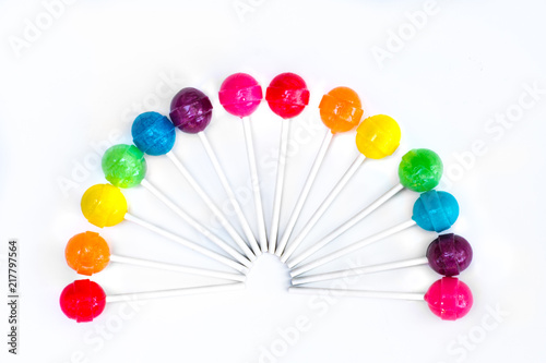 Rainbow design of sweet colorful lollipops against white background Tableau sur Toile