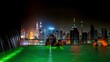 Womans swimming to the edge of rooftop swimming pool to enjoy the night cityscape of Kuala Lumpur, Malaysia Timelapse 4K