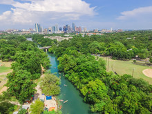 Aerial View Downtown From Barton Creek In Greenbelt At Zilker Metropolitan Park South Austin With Summer Blue Cloud Sky. Located At Eastern Edge Of Hill Country, Austin The State Capital Of Texas, US.