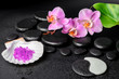 spa concept of zen and Yin-Yang stones, lilac orchid