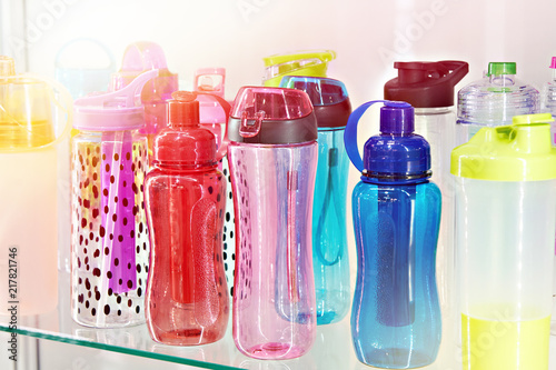 Sports colored plastic bottles for drinking water in shop