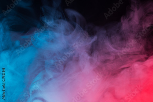 Staande foto Rook Colorful smoke close-up on a black background