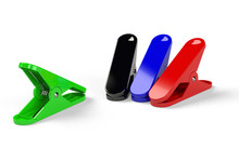 Several Clippers Of Different Colours  Placed On The White Background