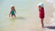 children play ball sea beach