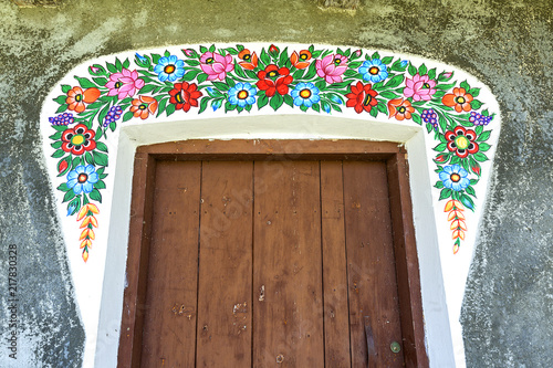 Fotografering  Painted old cottage decorated with a hand painted colorful floral motives, folk