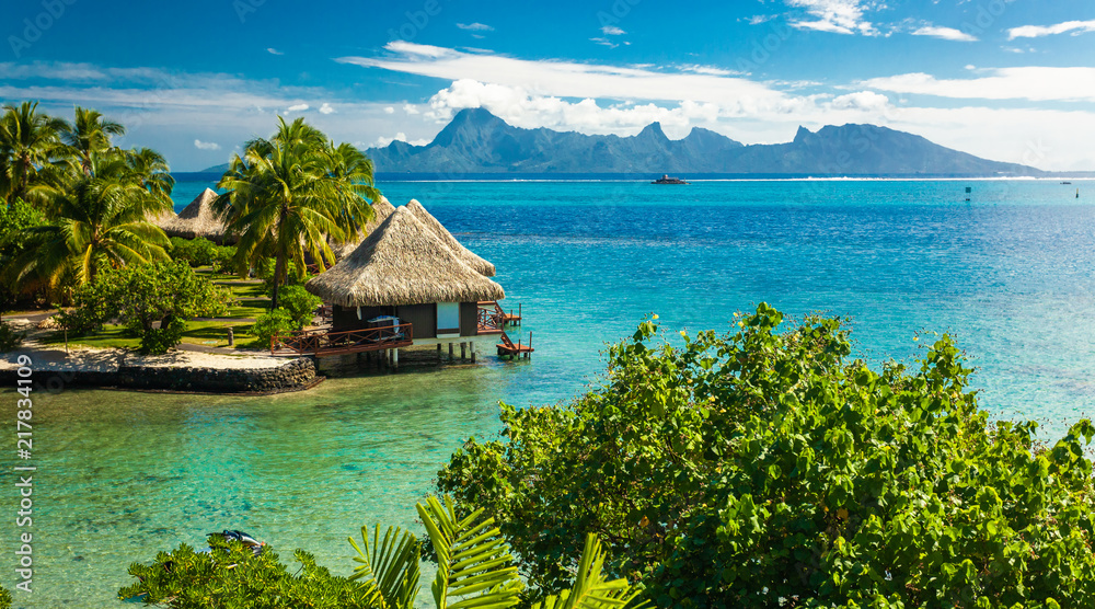 Fototapeta Overwater bungalows with best beach for snorkeling, Tahiti, French Polynesia