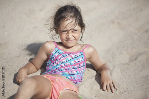 Valokuvatapetti Little girl 6 years old on the beach in Spain near Alicante city
