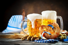 Beer Mugs And Pretzels On A Wooden Table. Oktoberfest. Beer Festival.