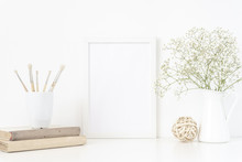 Back To School. White Frame Mockup A4 In Interior With Vintage Elements . Frame Mock Up Background. Indoor, Frame On Table With Flowers In Jug And Vintage Books. Summer Sea Mood
