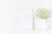 White Frame Mockup A4 In Interior. Frame Mock Up Background For Poster Or Photo Frame For Bloggers, Social Media, Lettering, Art And Design. Indoor, Frame On Table With Flowers In Jug, Stationary.