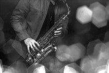 Jazz Saxophone Player In Performance On The Stage. Color Filter And Hexagon Bokeh Added.