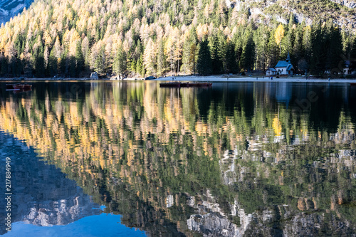 Fall scenery of lake Braies. Lago di Braies at Alps background in South Tyrol in Italy.