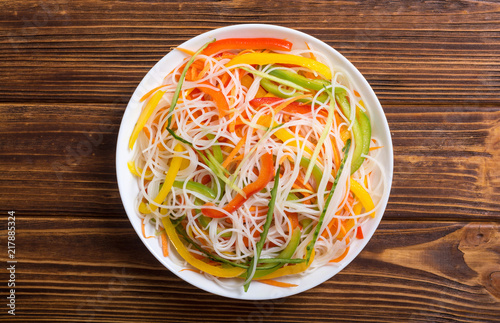 Salad from rice noodles with vegetables