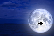 Full Moon Back Silhouette Boat On Night Sea