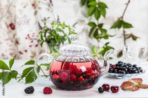 Fotografia  Image with berry tea.