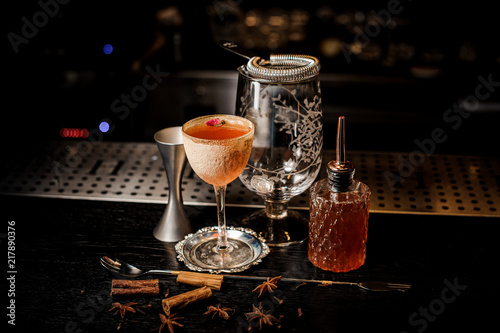 Elegant cocktail glass with tasty and sweet summer drink decorated with flower and powder