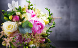 Fototapeta Kwiaty - Composition with bouquet of freshly cut flowers