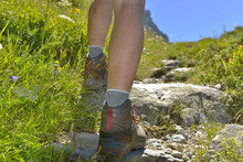 Close On Legs Of A Woman Hiking On A Pathin Mountain